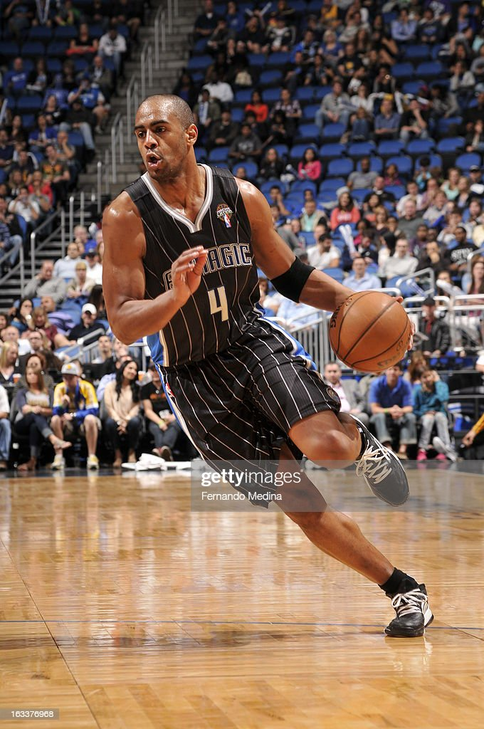 Arron Afflalo #4 of the Orlando Magic drives to the basket against the Indiana Pacers on March 8, 2013 at Amway Center in Orlando, Florida.