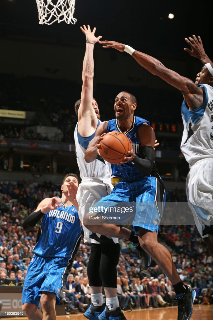 <a gi-track='captionPersonalityLinkClicked' href=/galleries/search?phrase=Arron+Afflalo&family=editorial&specificpeople=640861 ng-click='$event.stopPropagation()'>Arron Afflalo</a> #4 of the Orlando Magic drives to the basket against the Minnesota Timberwolves during the season and home opening game on October 30, 2013 at Target Center in Minneapolis, Minnesota.
