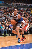 Arron Afflalo of the Orlando Magic drives to the basket against the Miami Heat on January 4 2014 at Amway Center in Orlando Florida NOTE TO USER User...