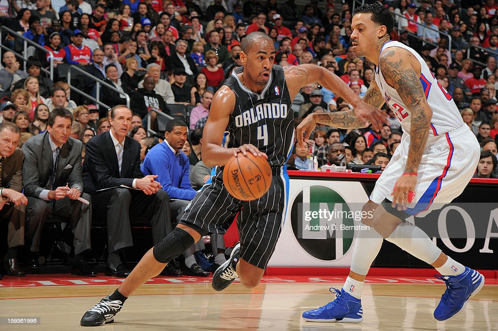 <a gi-track='captionPersonalityLinkClicked' href=/galleries/search?phrase=Arron+Afflalo&family=editorial&specificpeople=640861 ng-click='$event.stopPropagation()'>Arron Afflalo</a> #4 of the Orlando Magic drives to the hoop against <a gi-track='captionPersonalityLinkClicked' href=/galleries/search?phrase=Matt+Barnes+-+Basketball+Player&family=editorial&specificpeople=202880 ng-click='$event.stopPropagation()'>Matt Barnes</a> #22 of the Los Angeles Clippers at Staples Center on January 12, 2013 in Los Angeles, California.