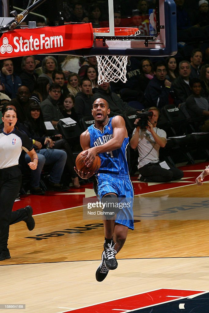 <a gi-track='captionPersonalityLinkClicked' href=/galleries/search?phrase=Arron+Afflalo&family=editorial&specificpeople=640861 ng-click='$event.stopPropagation()'>Arron Afflalo</a> #4 of the Orlando Magic dunks theball against the Washington Wizards at the Verizon Center on December 28, 2012 in Washington, DC.