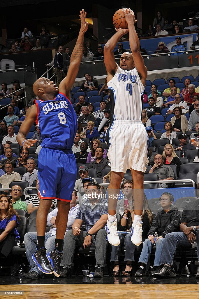 Arron Afflalo #4 of the Orlando Magic goes for a jump shot against Damien Wilkins #8 of the Philadelphia 76ers during the game between the Philadelphia 76ers and the Orlando Magic on March 10, 2013 at Amway Center in Orlando, Florida.