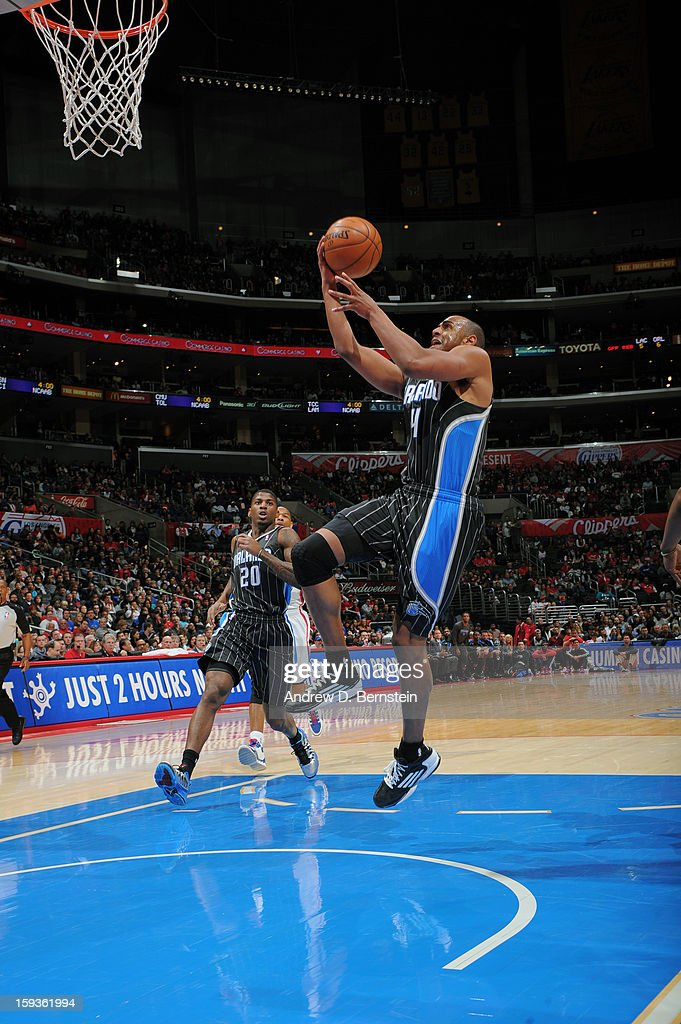 <a gi-track='captionPersonalityLinkClicked' href=/galleries/search?phrase=Arron+Afflalo&family=editorial&specificpeople=640861 ng-click='$event.stopPropagation()'>Arron Afflalo</a> #4 of the Orlando Magic goes strong to the basket against the Los Angeles Clippers at Staples Center on January 12, 2013 in Los Angeles, California.