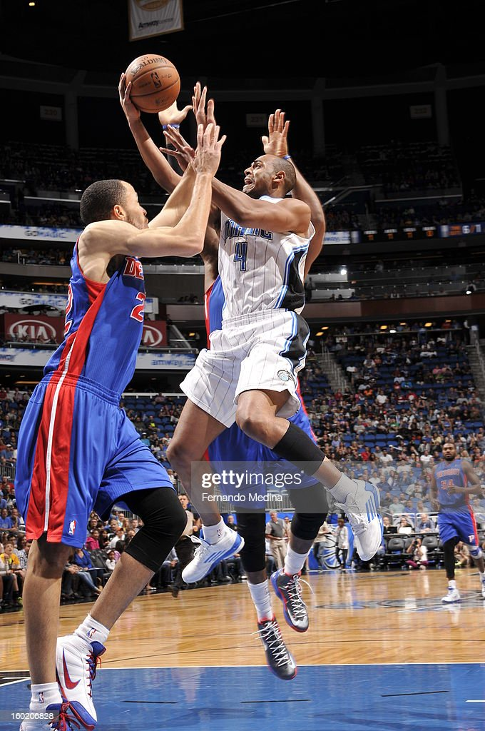 Arron Afflalo #4 of the Orlando Magic goes to the basket under pressure during the game between the Detroit Pistons and the Orlando Magic on January 27, 2013 at Amway Center in Orlando, Florida.