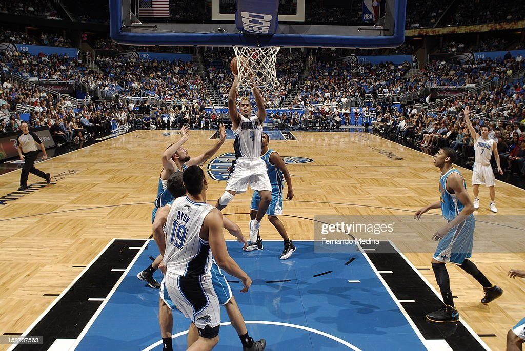 <a gi-track='captionPersonalityLinkClicked' href=/galleries/search?phrase=Arron+Afflalo&family=editorial&specificpeople=640861 ng-click='$event.stopPropagation()'>Arron Afflalo</a> #4 of the Orlando Magic goes up for the close shot against the New Orleans Hornets during the game on December 26, 2012 at Amway Center in Orlando, Florida.