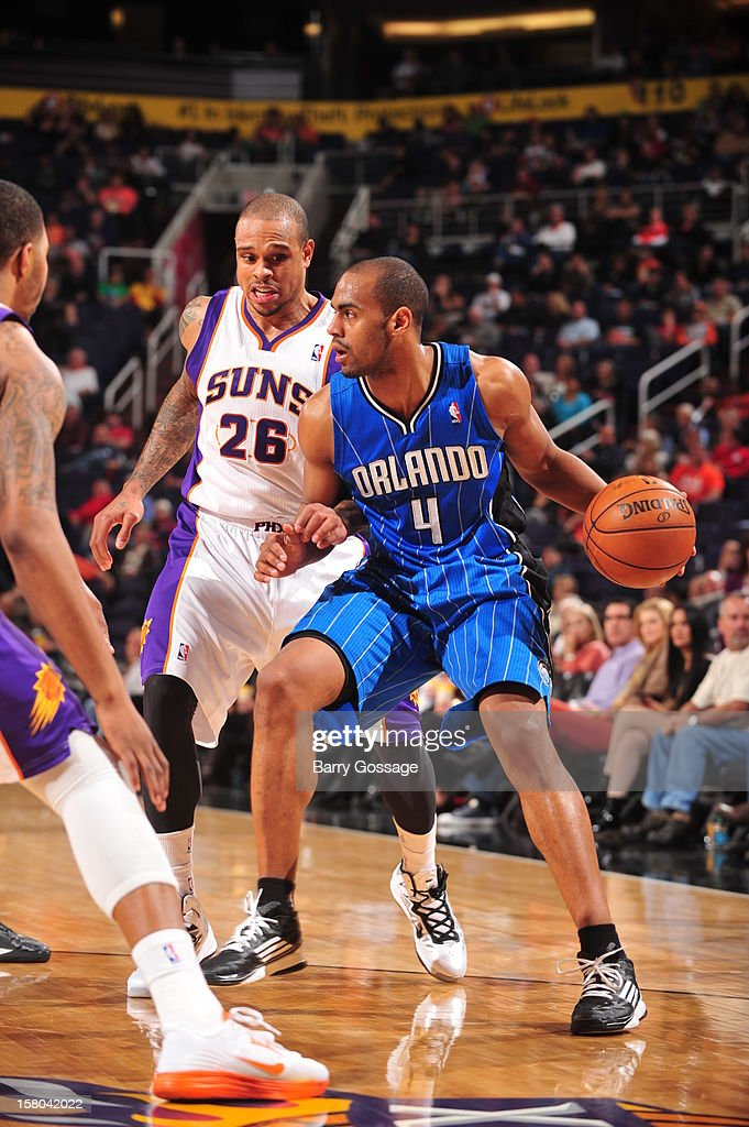 Arron Afflalo #4 of the Orlando Magic is guarded by Shannon Brown #26 of the Phoenix Suns on December 9, 2012 at U.S. Airways Center in Phoenix, Arizona.
