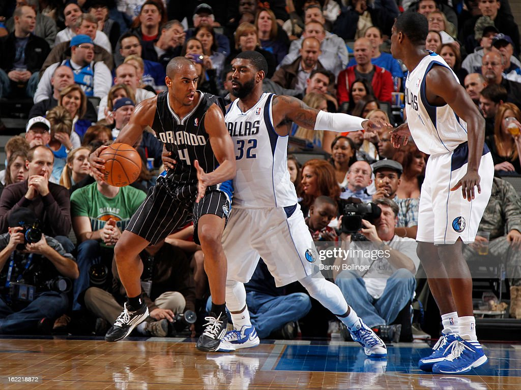 Arron Afflalo #4 of the Orlando Magic posts up against O.J. Mayo #32 of the Dallas Mavericks on February 20, 2013 at the American Airlines Center in Dallas, Texas.