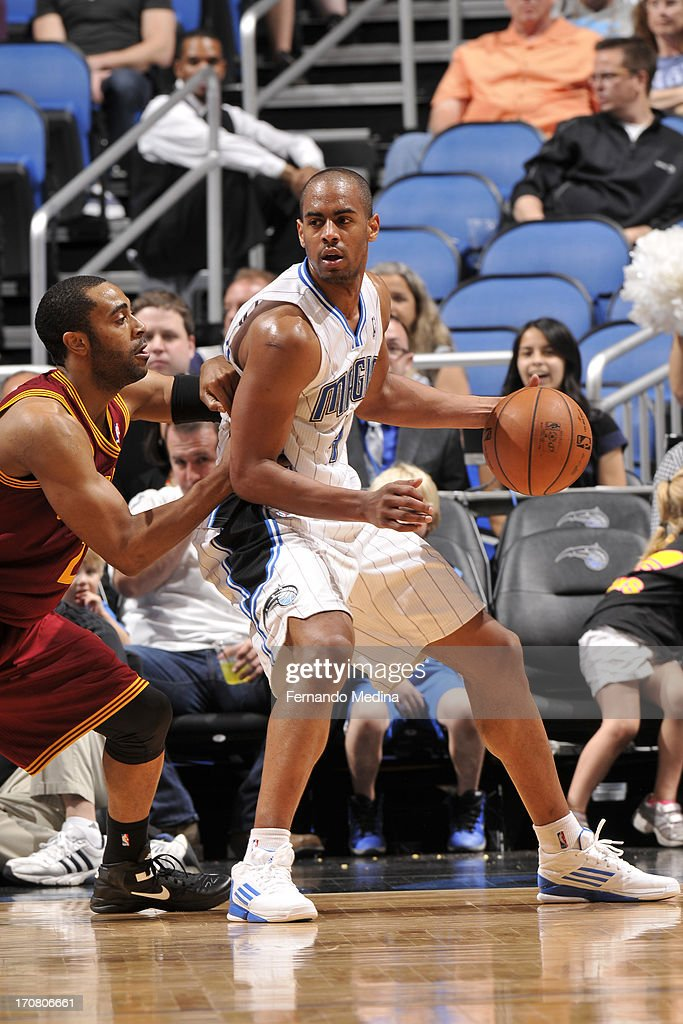 Arron Afflalo #4 of the Orlando Magic protects the ball against Wayne Ellington #21 of the Cleveland Cavaliers during the game on February 23, 2013 at Amway Center in Orlando, Florida.