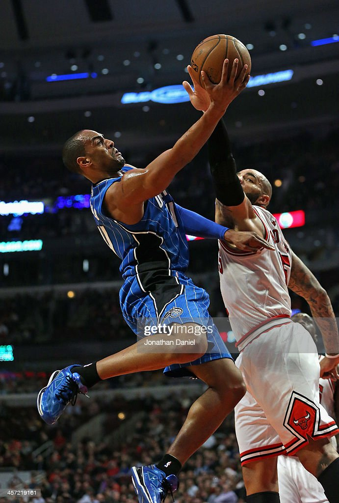 <a gi-track='captionPersonalityLinkClicked' href=/galleries/search?phrase=Arron+Afflalo&family=editorial&specificpeople=640861 ng-click='$event.stopPropagation()'>Arron Afflalo</a> #4 of the Orlando Magic puts up a shot against <a gi-track='captionPersonalityLinkClicked' href=/galleries/search?phrase=Carlos+Boozer&family=editorial&specificpeople=201638 ng-click='$event.stopPropagation()'>Carlos Boozer</a> #5 of the Chicago Bulls at the United Center on December 16, 2013 in Chicago, Illinois.