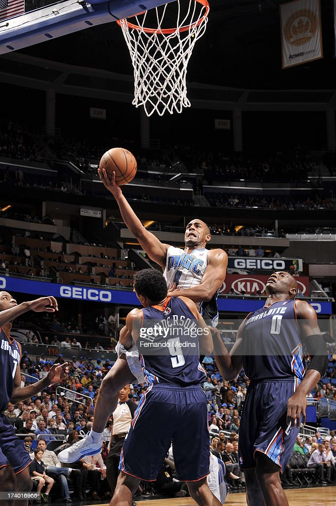 Arron Afflalo #4 of the Orlando Magic shoots a layup against Gerald Henderson #9 of the Charlotte Bobcats during the game on February 19, 2013 at Amway Center in Orlando, Florida.