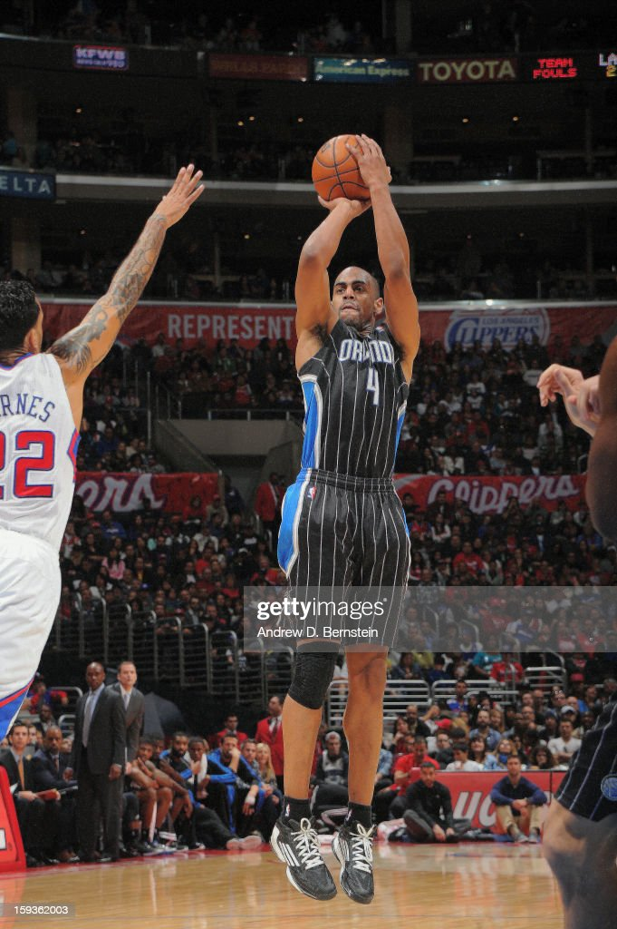 <a gi-track='captionPersonalityLinkClicked' href=/galleries/search?phrase=Arron+Afflalo&family=editorial&specificpeople=640861 ng-click='$event.stopPropagation()'>Arron Afflalo</a> #4 of the Orlando Magic shoots a three point shot against <a gi-track='captionPersonalityLinkClicked' href=/galleries/search?phrase=Matt+Barnes+-+Basketball+Player&family=editorial&specificpeople=202880 ng-click='$event.stopPropagation()'>Matt Barnes</a> #22 of the Los Angeles Clippers at Staples Center on January 12, 2013 in Los Angeles, California.