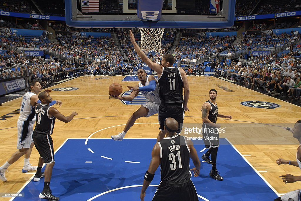 <a gi-track='captionPersonalityLinkClicked' href=/galleries/search?phrase=Arron+Afflalo&family=editorial&specificpeople=640861 ng-click='$event.stopPropagation()'>Arron Afflalo</a> #4 of the Orlando Magic shoots against <a gi-track='captionPersonalityLinkClicked' href=/galleries/search?phrase=Brook+Lopez&family=editorial&specificpeople=3847328 ng-click='$event.stopPropagation()'>Brook Lopez</a> #11 of the Brooklyn Nets on November 3, 2013 at Amway Center in Orlando, Florida.