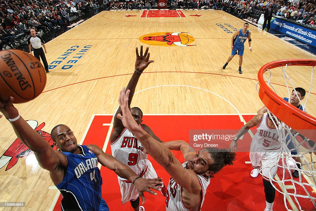 <a gi-track='captionPersonalityLinkClicked' href=/galleries/search?phrase=Arron+Afflalo&family=editorial&specificpeople=640861 ng-click='$event.stopPropagation()'>Arron Afflalo</a> #4 of the Orlando Magic shoots against (L-R) <a gi-track='captionPersonalityLinkClicked' href=/galleries/search?phrase=Luol+Deng&family=editorial&specificpeople=202830 ng-click='$event.stopPropagation()'>Luol Deng</a> #9 and <a gi-track='captionPersonalityLinkClicked' href=/galleries/search?phrase=Joakim+Noah&family=editorial&specificpeople=699038 ng-click='$event.stopPropagation()'>Joakim Noah</a> #13 of the Chicago Bulls during the NBA game on November 6, 2012 at the United Center in Chicago, Illinois.
