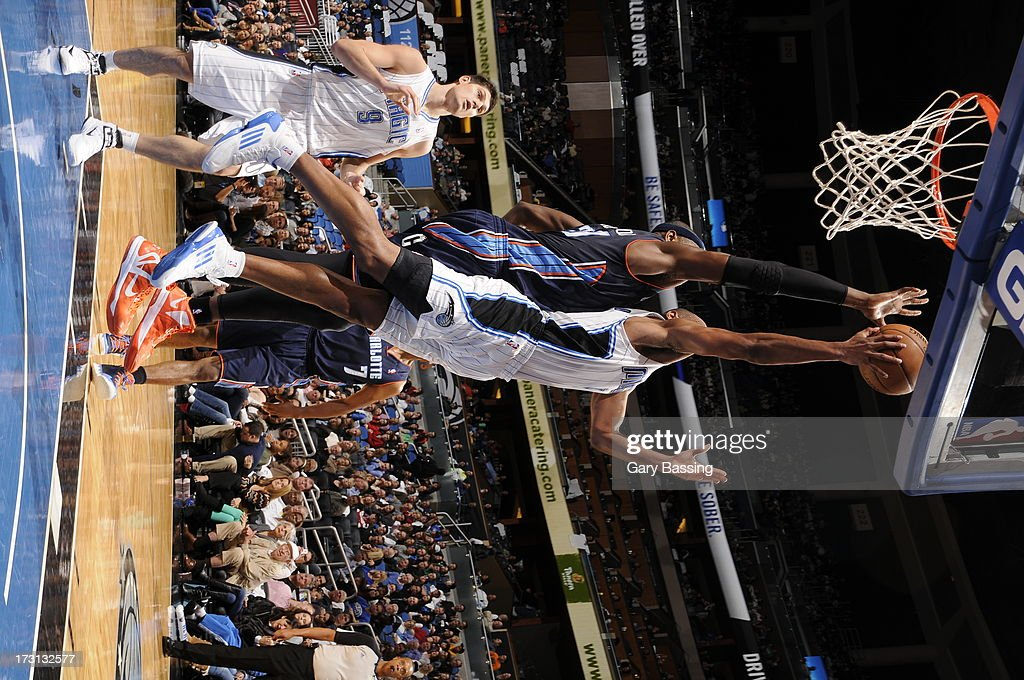 Arron Afflalo #4 of the Orlando Magic shoots over Brendan Haywood #33 of the Charlotte Bobcats during a game on January 18, 2013 at Amway Center in Orlando, Florida.