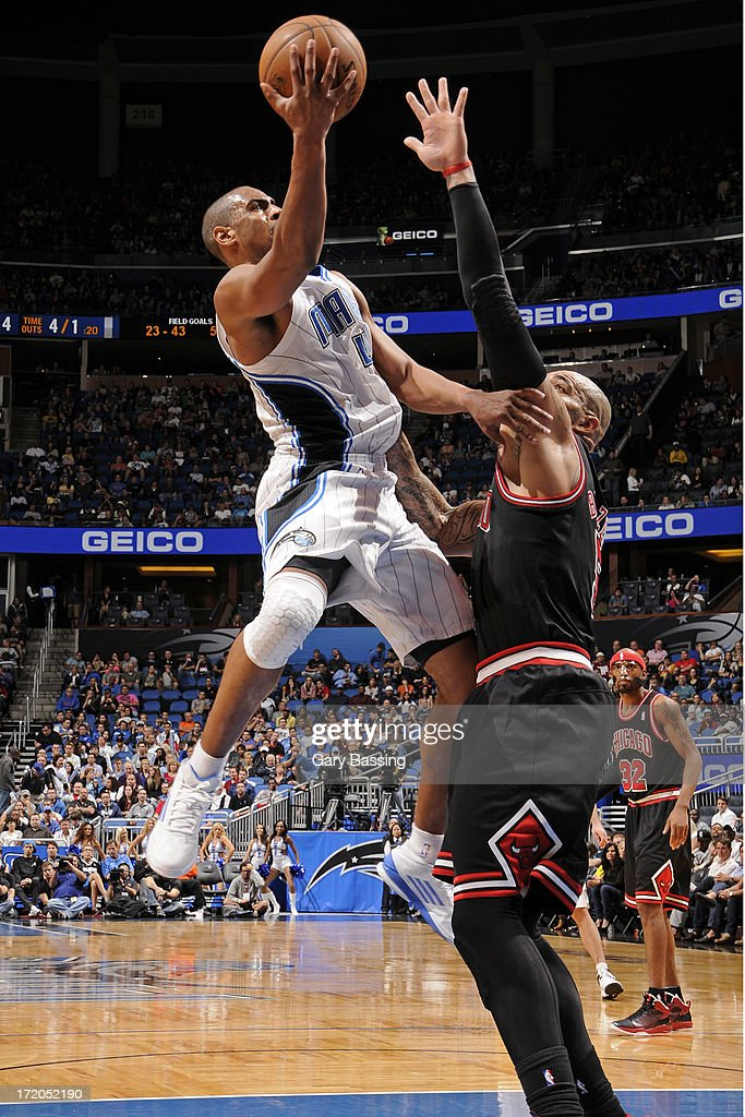 <a gi-track='captionPersonalityLinkClicked' href=/galleries/search?phrase=Arron+Afflalo&family=editorial&specificpeople=640861 ng-click='$event.stopPropagation()'>Arron Afflalo</a> #4 of the Orlando Magic shoots over <a gi-track='captionPersonalityLinkClicked' href=/galleries/search?phrase=Carlos+Boozer&family=editorial&specificpeople=201638 ng-click='$event.stopPropagation()'>Carlos Boozer</a> #5 of the Chicago Bulls during a game on January 2, 2013 at Amway Center in Orlando, Florida.