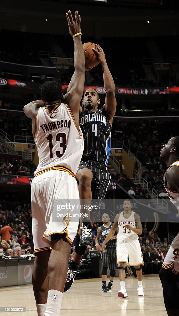 Arron Afflalo #4 of the Orlando Magic shoots over Tristan Thompson #13 of the Cleveland Cavaliers at The Quicken Loans Arena on February 8, 2013 in Cleveland, Ohio.