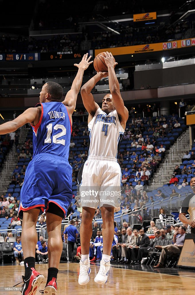 Arron Afflalo #4 of the Orlando Magic shoots the ball against Evan Turner #12 of the Philadelphia 76ers during the game on March 10, 2013 at Amway Center in Orlando, Florida.