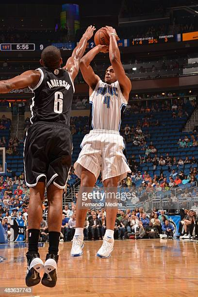 Arron Afflalo of the Orlando Magic shoots the ball against the Brooklyn Nets during the game on April 9 2014 at Amway Center in Orlando Florida NOTE...