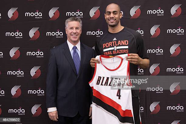 Arron Afflalo of the Portland Trail Blazers is introduced to the media by General Manager Neil Olshey on February 21 2015 at the Trail Blazer...