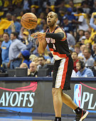 Arron Afflalo of the Portland Trailblazers passes against the Memphis Grizzlies in Game 5 of the first round of the 2015 NBA Playoffs at FedExForum...