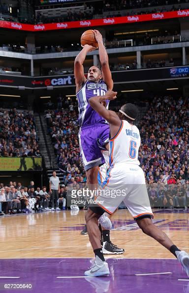 Arron Afflalo of the Sacramento Kings shoots against Semaj Christon of the Oklahoma City Thunder on November 23 2016 at Golden 1 Center in Sacramento...