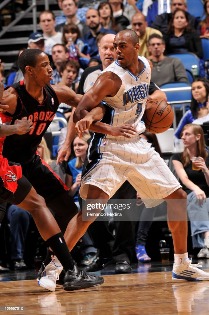 Arron Afflalo #4 of the Toronto Raptors looks to pass against DeMar DeRozan #10 of the Orlando Magic during the game on January 24, 2013 at Amway Center in Orlando, Florida.