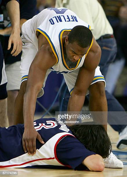 Arron Afflalo of the UCLA Bruins consoles Adam Morrison of the the Gonzaga Bulldogs after losing in the third round game of the NCAA Division I Men's...