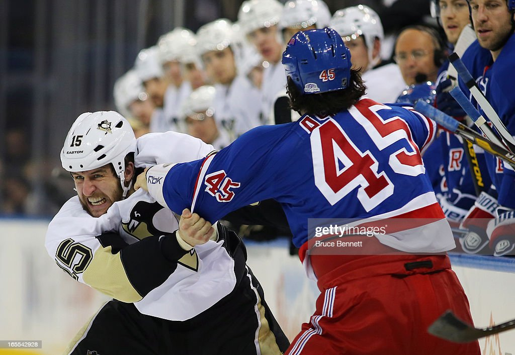 <a gi-track='captionPersonalityLinkClicked' href=/galleries/search?phrase=Arron+Asham&family=editorial&specificpeople=203158 ng-click='$event.stopPropagation()'>Arron Asham</a> #45 of the New York Rangers and <a gi-track='captionPersonalityLinkClicked' href=/galleries/search?phrase=Tanner+Glass&family=editorial&specificpeople=4596666 ng-click='$event.stopPropagation()'>Tanner Glass</a> #15 of the Pittsburgh Penguins fight during the third period at Madison Square Garden on April 3, 2013 in New York City. The Rangers defeated the Penguins 6-1.