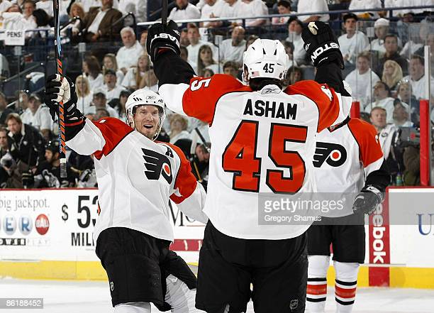 Arron Asham of the Philadelphia Flyers celebrates his goal with Kimmo Timonen against the Pittsburgh Penguins during Game Five of the Eastern...