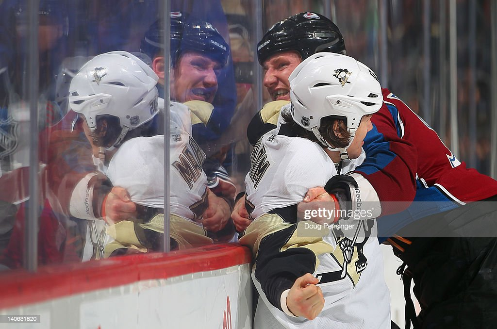 Arron Asham of the Pittsburgh Penguins and Cody McLeod of the Colorado Avalanche engage in a fight in the first period at the Pepsi Center on March 3...