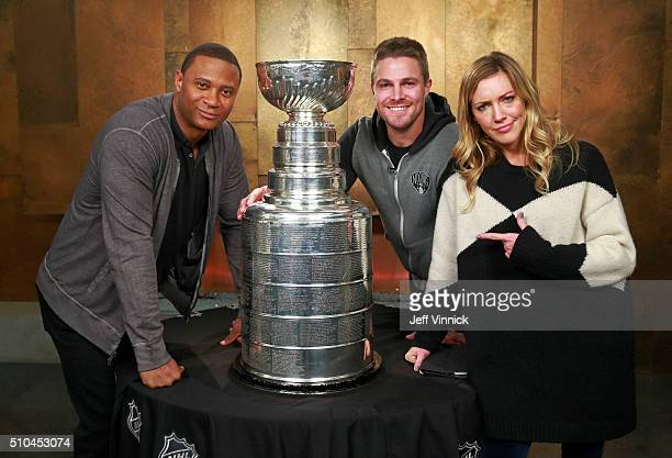 'Arrow' actors David Ramsey Stephen Amell and Katie Cassidy pose with the Stanley Cup on the set of 'Arrow' February 15 2016 in Vancouver British...