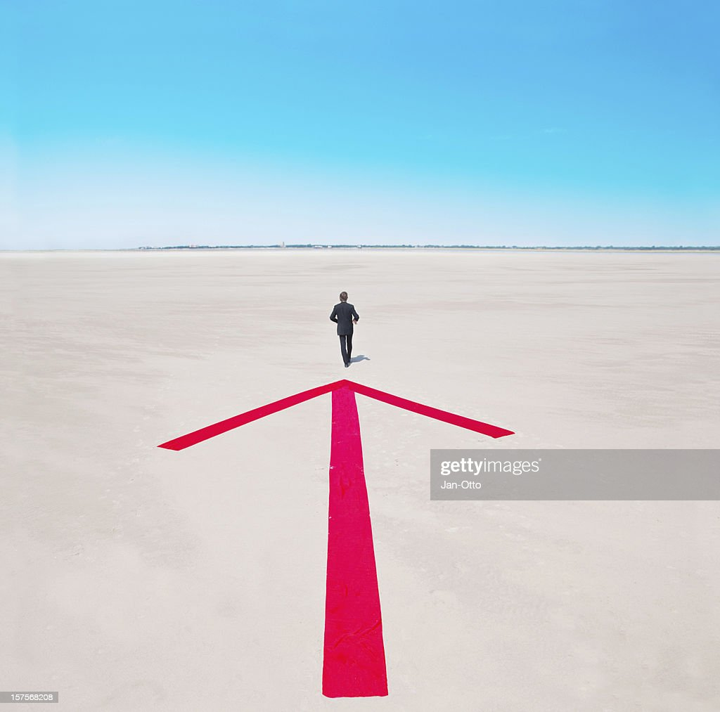Arrow indicating way out of desert : Stock Photo