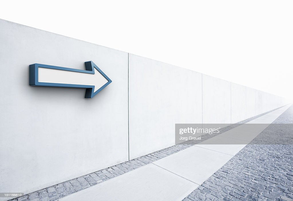 Arrow pointing into distance : Stock Photo