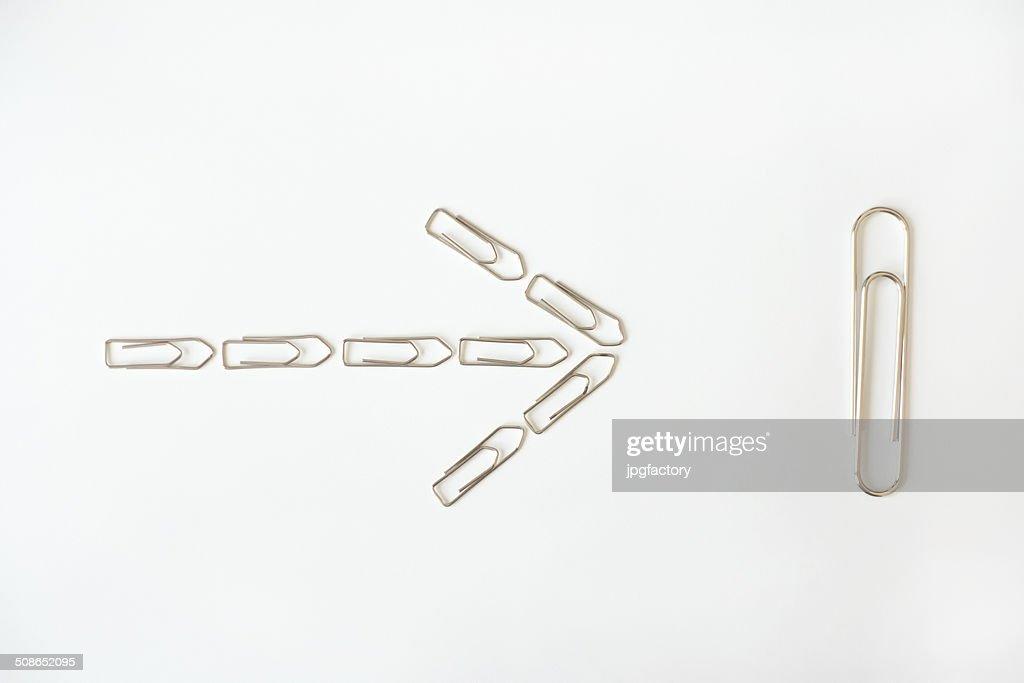 arrow shaped paper clips : Stock Photo