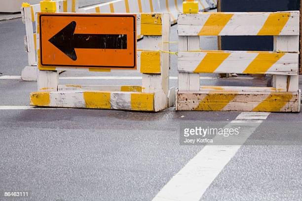 Arrow sign at road construction site
