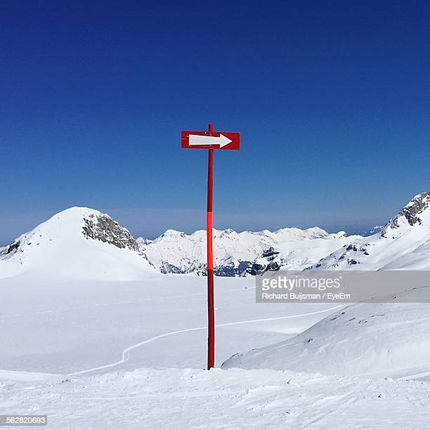 Arrow Sign In Snowcapped Mountains