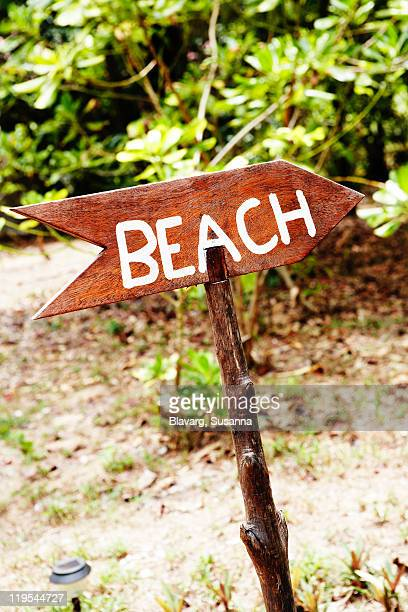 Arrow sign with beach written on it