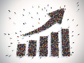 Crowd of people forms an arrow with statistic graph