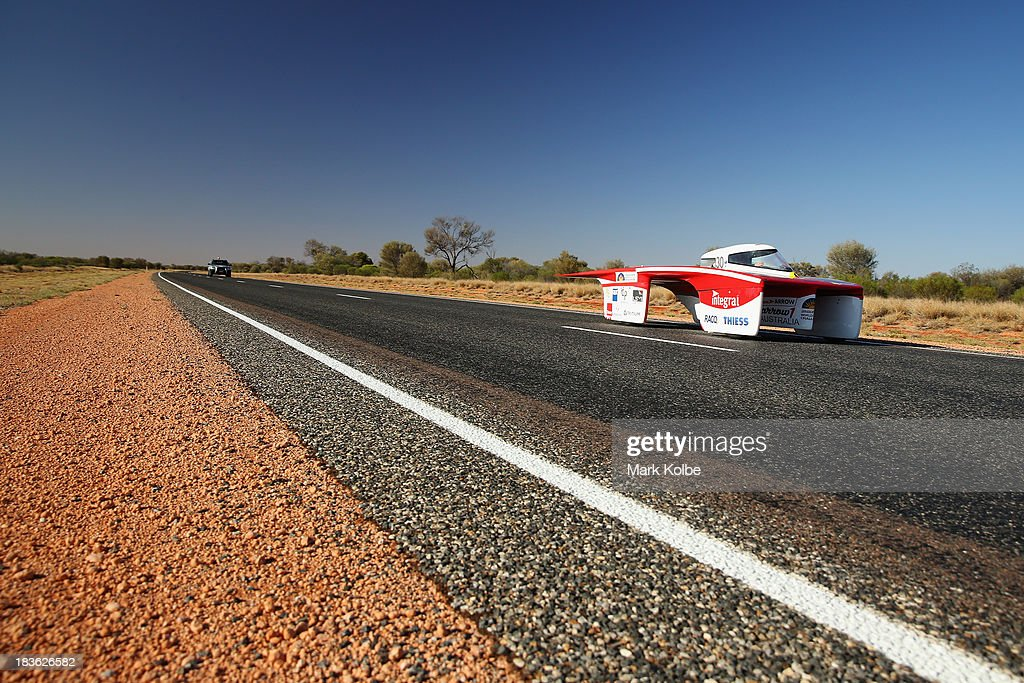 Arrow1 from Team Arrow, Associated with Queensland University of Technology in Australia races in the Clipsal and Schneider Electric Challenger Class on Day 3 on October 8, 2013 outside of Alice Springs, Australia. Over 25 teams from across the globe are competing in the 2013 World Solar Challenge - a 3000 km solar-powered vehicle race between Darwin and Adelaide. The race began on October 6th with the first car expected to cross the finish line on October 10th.