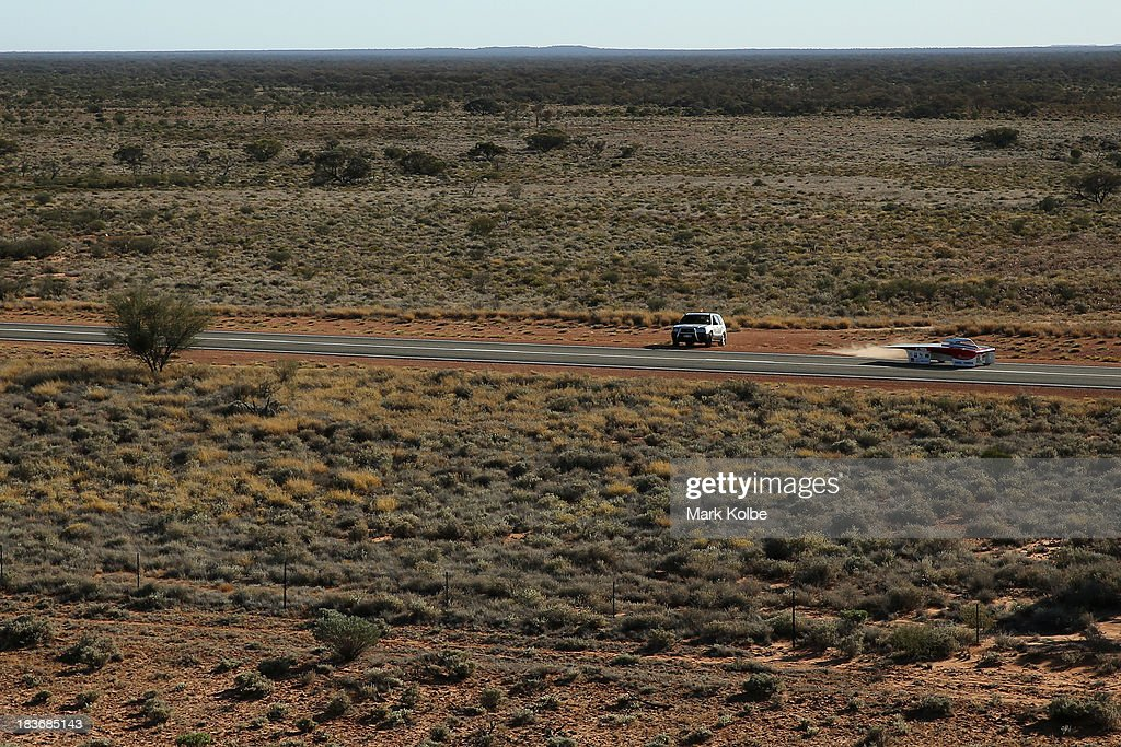 Arrow1 from Team Arrow, Associated with Queensland University of Technology in Australia pulls out from their overnight camping spot to begin racing on Day 4 on October 9, 2013 between Alice Springs and Kulgera, Australia. Over 25 teams from across the globe are competing in the 2013 World Solar Challenge - a 3000 km solar-powered vehicle race between Darwin and Adelaide. The race began on October 6th with the first car expected to cross the finish line on October 10th.
