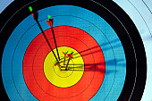 archery target hit by four arrows