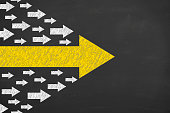 Arrows Leadership Concept on Chalkboard