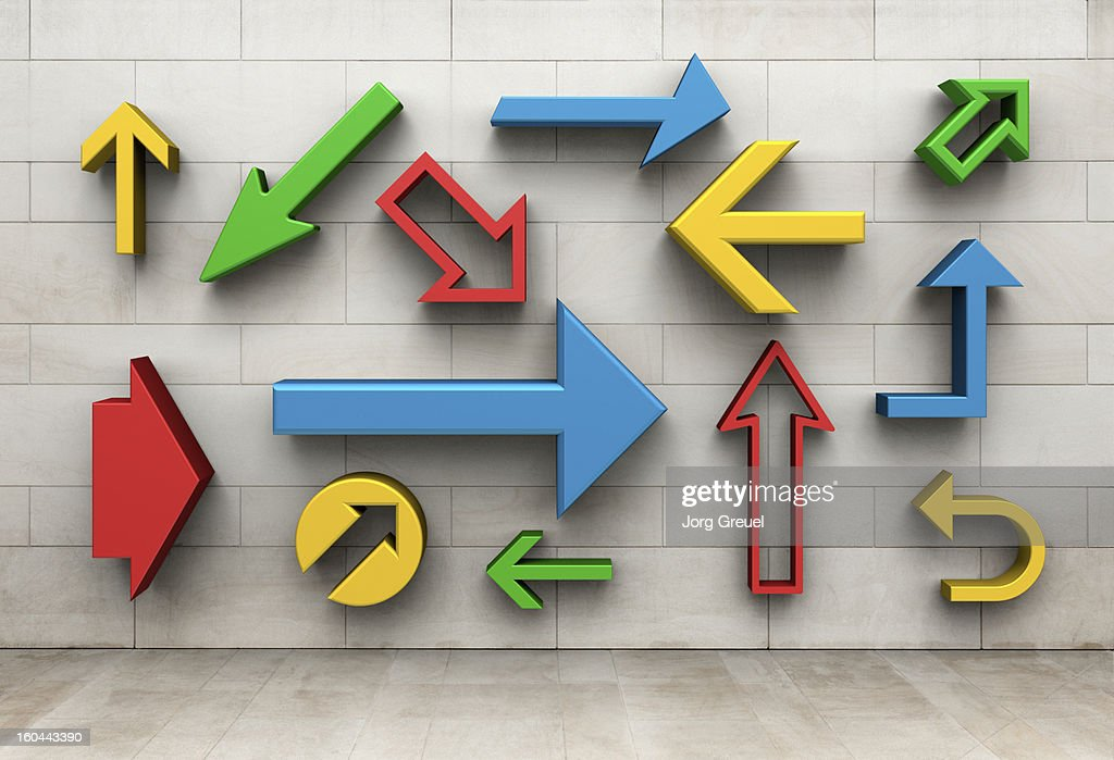 Arrows pointing in different directions : Stock Photo