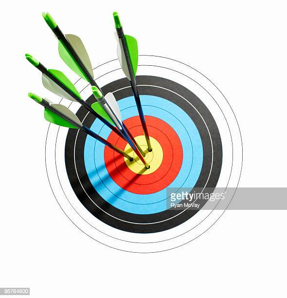 arrows throught the center of a bullseye target