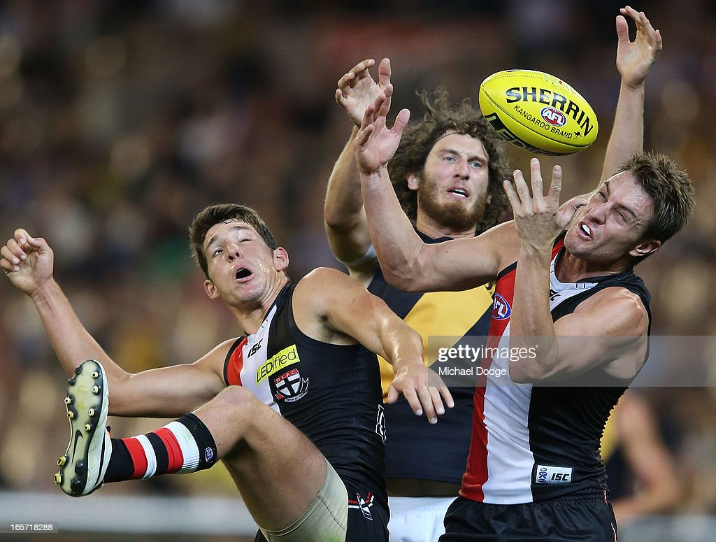 Arryn Sippos (L) and Sam Fisher of the Saints contest for the ball against Ty Vickery of the Tigers during the round two AFL match between the St Kilda Saints and the Richmond Tigers at Melbourne Cricket Ground on April 5, 2013 in Melbourne, Australia.
