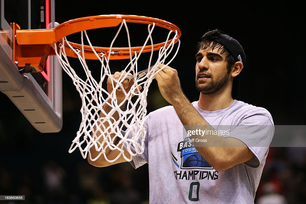 Arsalan Kazemi #14 of the Oregon Ducks celebrates by cutting down the net after they defeated the UCLA Bruins 78 to 69 in the Pac-12 Championship game at MGM Grand Garden Arena on March 16, 2013 in Las Vegas, Nevada.