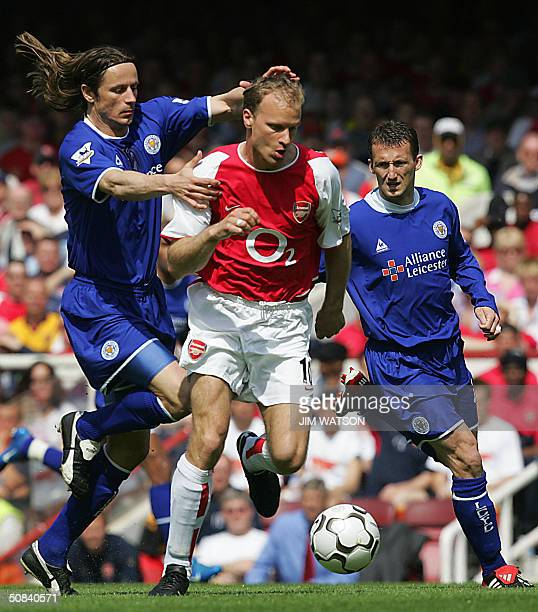 Arseanl's Dennis Bergkamp keeps the ball away from Leicester City's Lilian Nalis and Billy McKinlay during their Premiership football match 15 May...