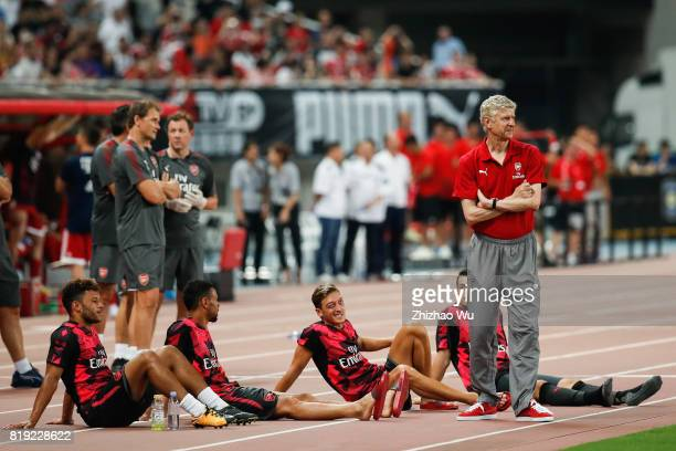 Arseen Wenger coach of Arsenal FC and Mesut Ozil during the 2017 International Champions Cup China match between FC Bayern and Arsenal FC at Shanghai...