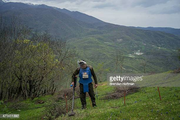 Arsen Anastasyan a sapper with the charity HALO Trust works to clear a minefield on April 20 2015 in Hagob Kamari NagornoKarabakh Since signing a...