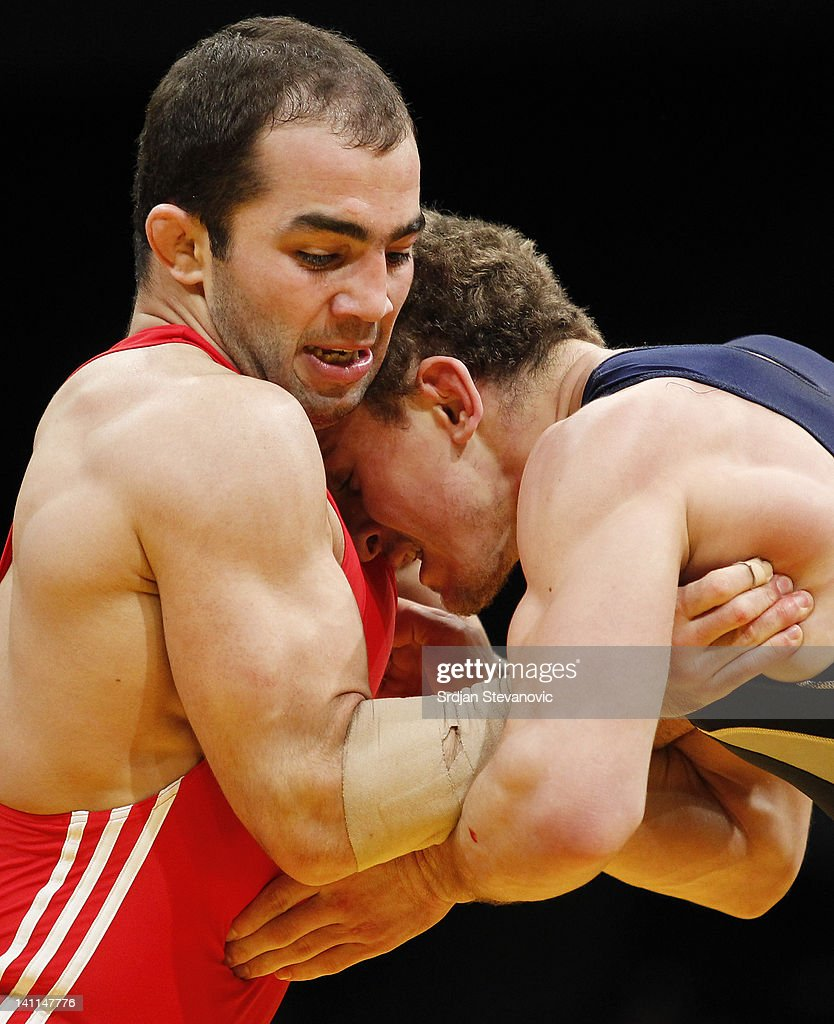 Arsen Julfalakyan of Armenia fights with Dmytro Pyshkov of Ukraine during bronze medal Men's GrecoRoman style 74kg match at the European Wrestling...